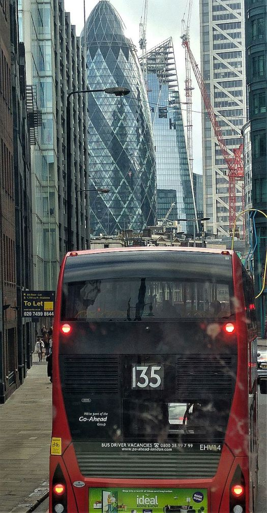 Creeping along behind another bus, finally The Gherkin ahead
