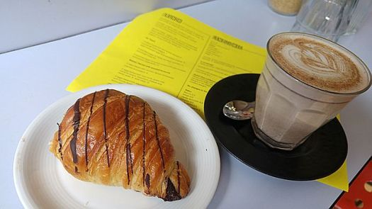 A not-flaky-or-chocolatey-enough chocolate croissant and a perfect handmade no-sugar chai latte at Fingers Crossed
