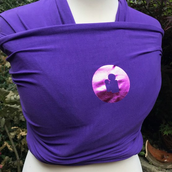 purple stretchy wrap with metallic pink logo