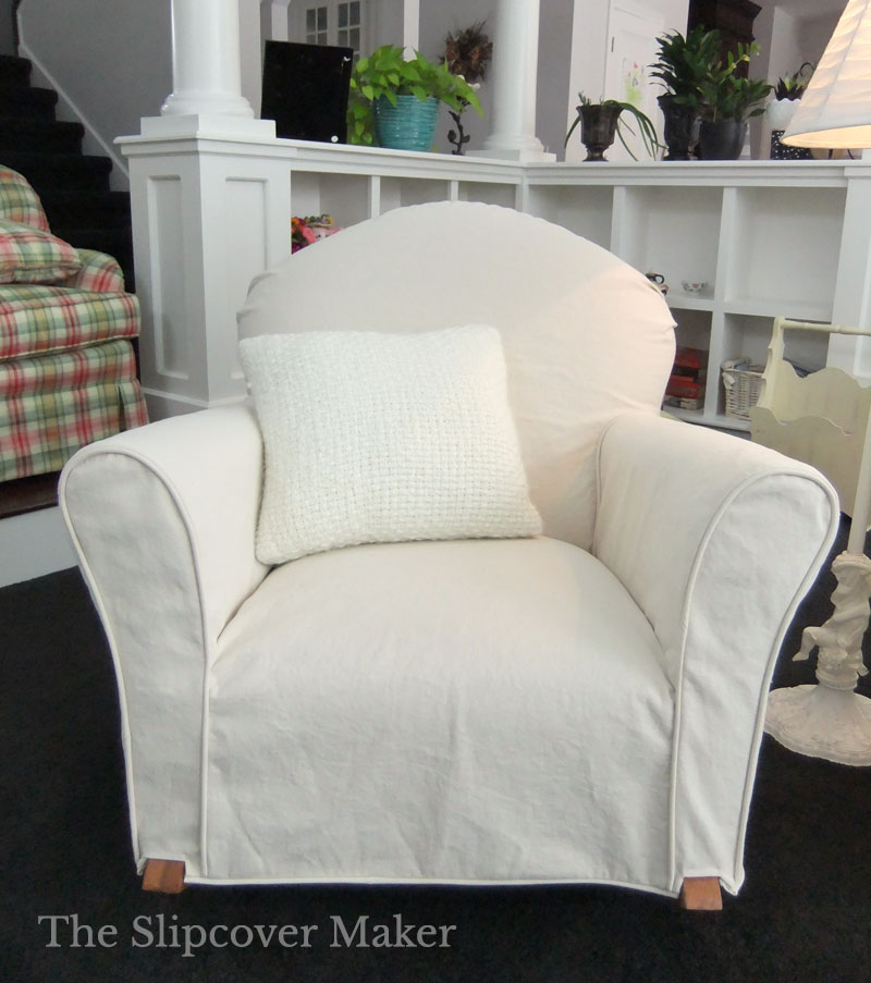 Small rocking chair with natural denim slipcover.