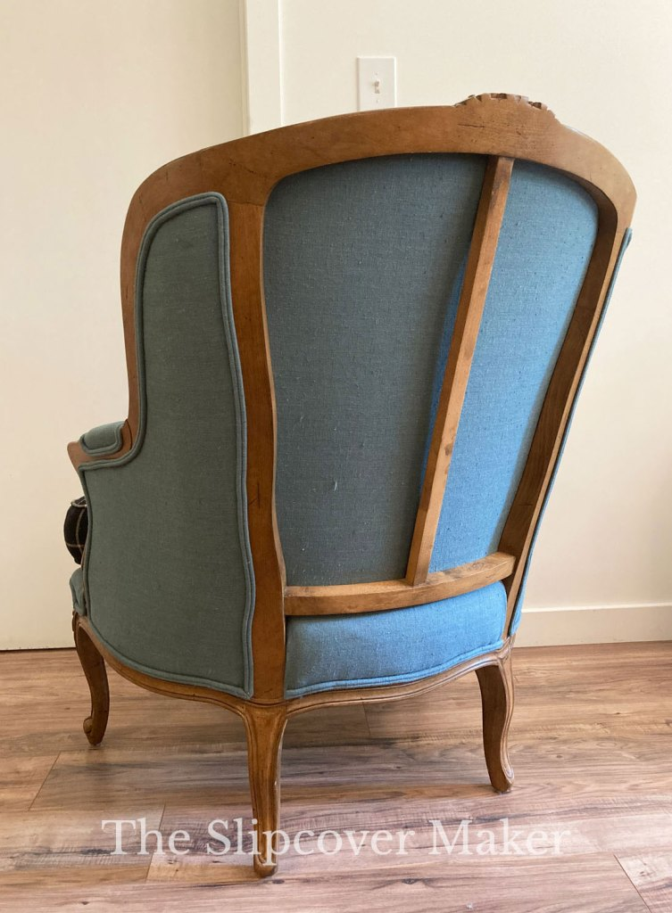 French chair back with exposed wood frame.