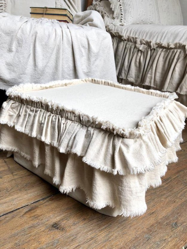 Ruffled dropcloth ottoman slipcover.