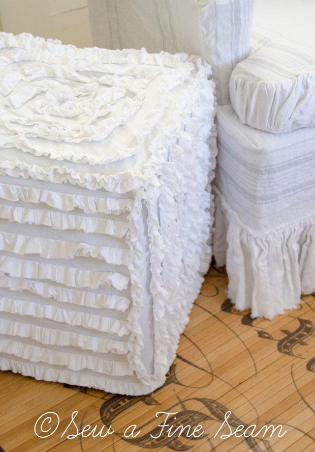 White ruffled cube ottoman cover.