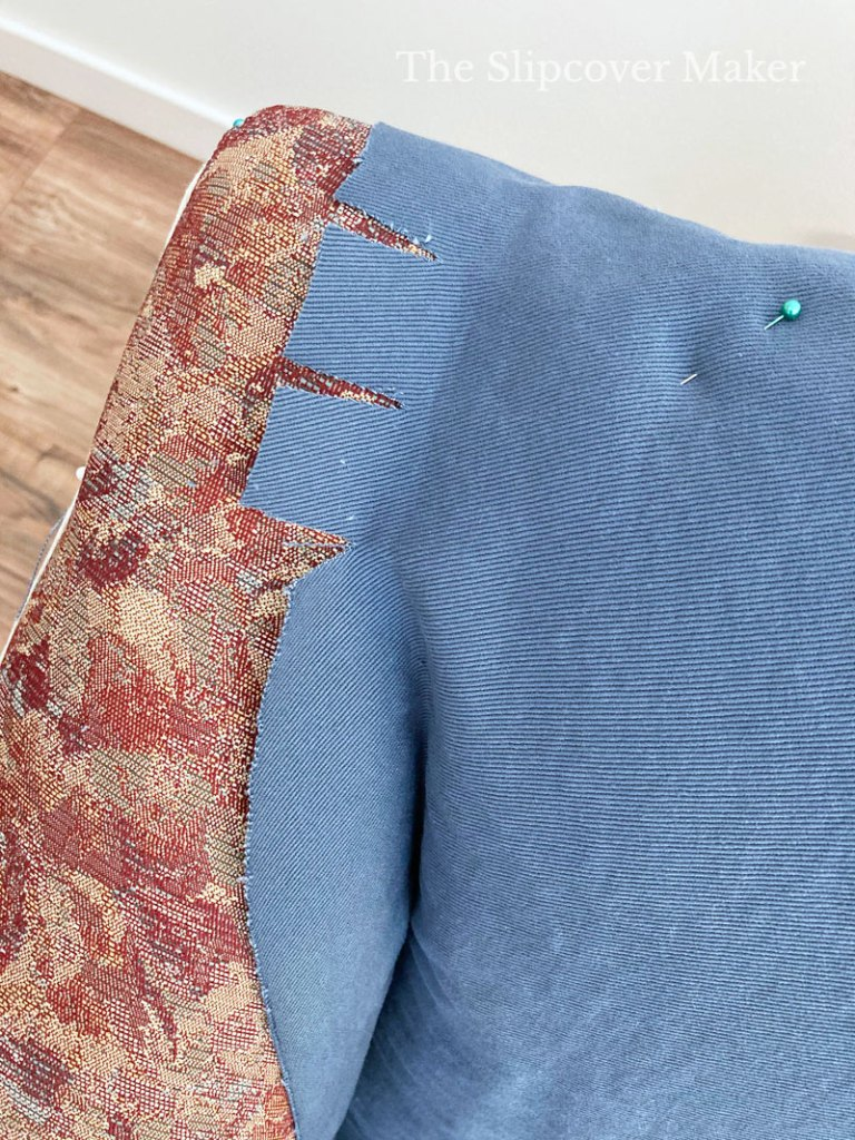 Blue fabric pinned to chair.