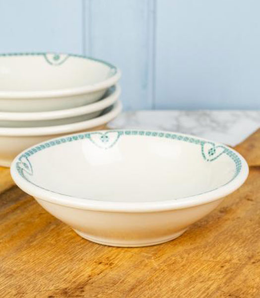 Old white ironstone cereal blow with blue trimmed edge.