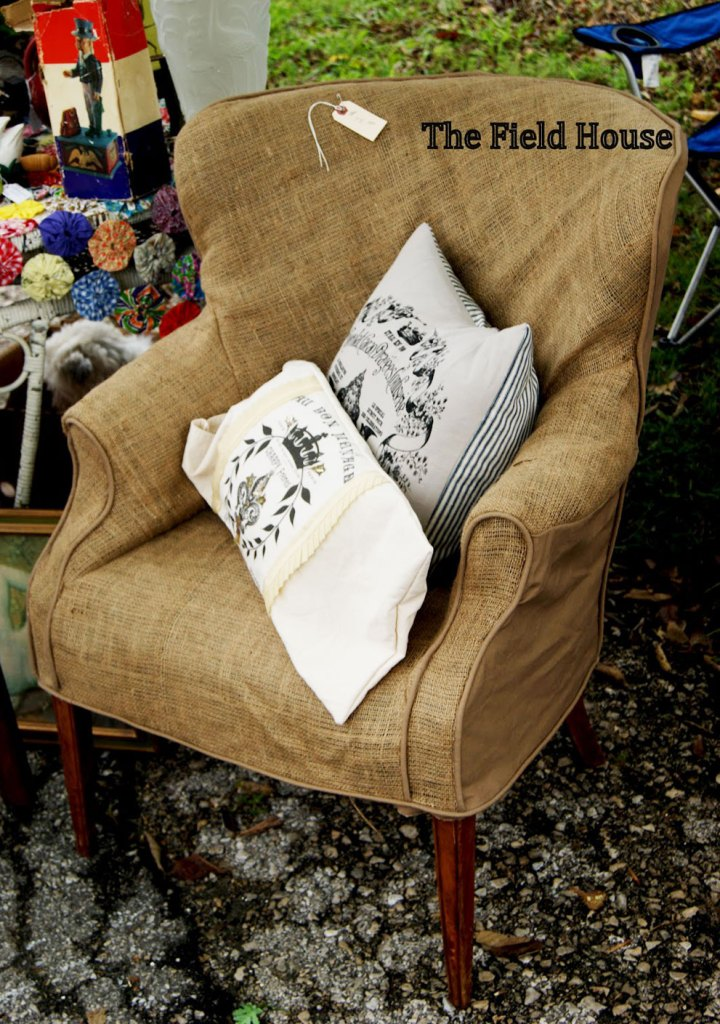 Rustic burlap slipcover on wingback chair with pillows.
