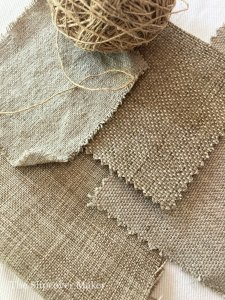 Burlap-like fabric swatches on table.