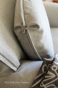Soft grey canvas back cushion on chair.