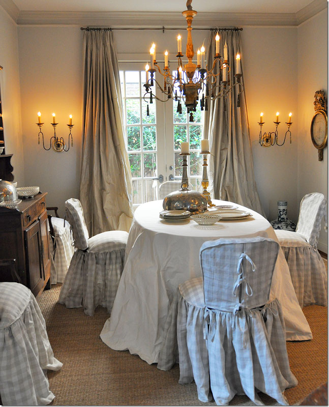 Dining chair slipcovers with gathered skirts.