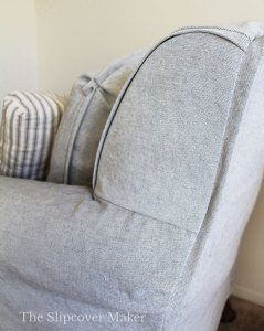 Grey canvas chair slipcover side panel.