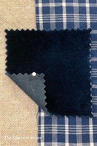 Dark blue thick velvet fabric.