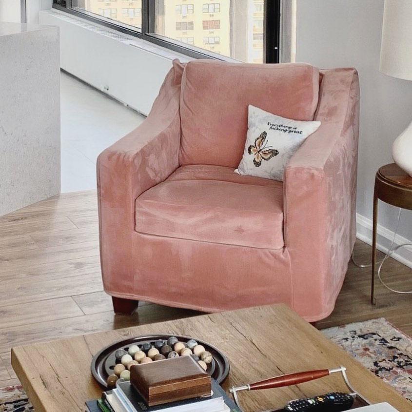 Pink velvet slipcover on armchair.