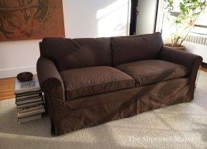 Dark brown silk slipcover on sofa.