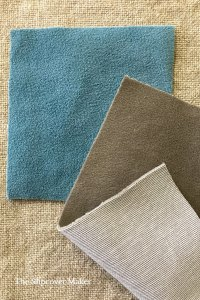 Aqua and beige velvet fabric swatches.
