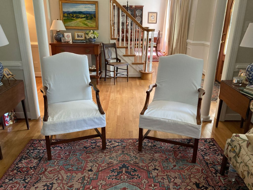 White slipcovered side chairs.