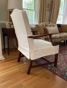 White denim side chair with slipcover.