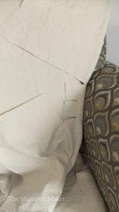 Canvas fabric clipped around inner arm seam.