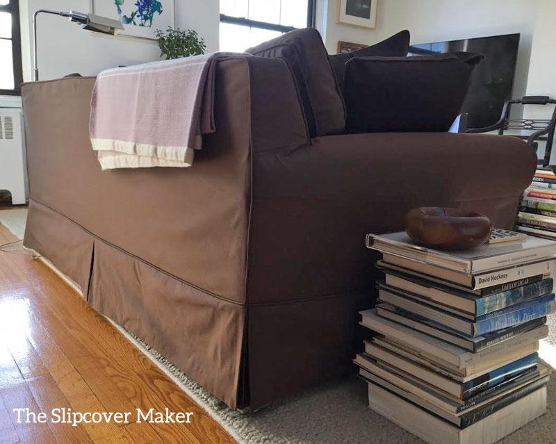 Chocolate brown silk sofa slipcover back view.