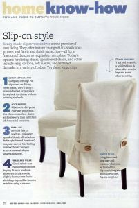 Loose fitting cream color chair slipcovers with buttons.