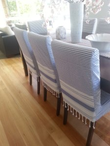 Blue chair slipcovers made from throw blankets.