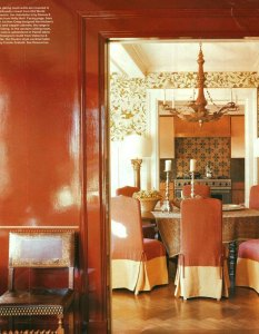 Orange and cream dining chair slipcovers.