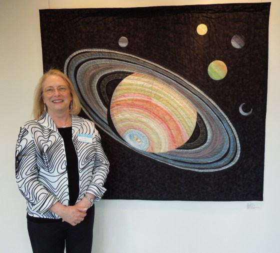 "Andi Perejda with her Art Quilt, ""Saturn II"""