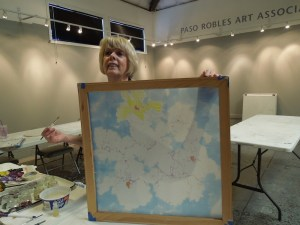 Liv Hansen demonstrates painting on silk in PRAA Classroom at Studios on the Park