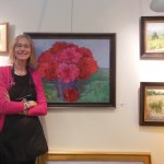 Susanna Hoy with her paintings