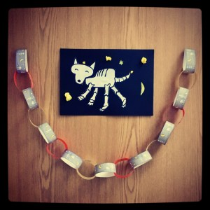 Hallowe'en paperchains and Funnybones dog skeleton collage.