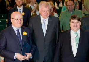 From left : Czech Minister of Culture Daniel Herman Bavarian governor Horst Seehofer and,the spokesman for the Sudeten Germans ethnic group, Bernd Posselt, attend the 67th Sudeten-Germans Day in Nuremberg, Germany, 1Sunday May 15, 2016. The meeting took place with the slogan 'Dialog verpflichtet' (lit. dialogue under obligation). (Daniel Karmann/dpa via AP)