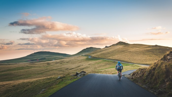 cyclist on mountain hilly terrain road