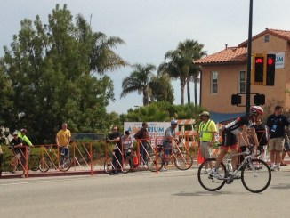 Two cyclists at the finish line at Avila
