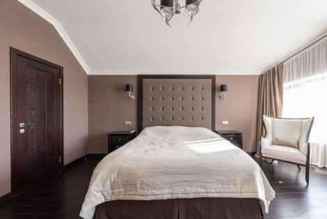 interior of classic styled bedroom with wooden details in daylight
