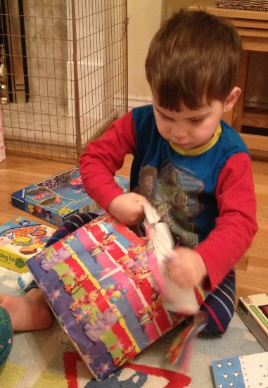 Toby opening presents