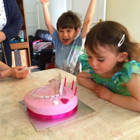 Kara blowing out candles on birthday cake