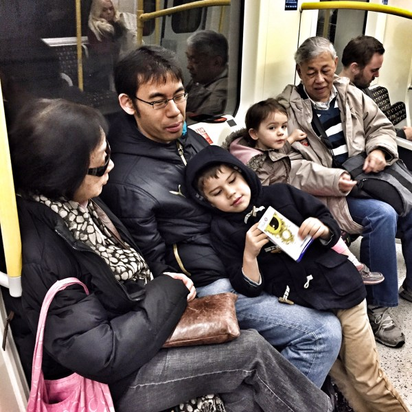 Three generations of Liew family on the tube