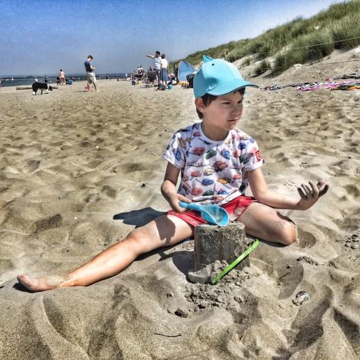 Toby building sandcastle