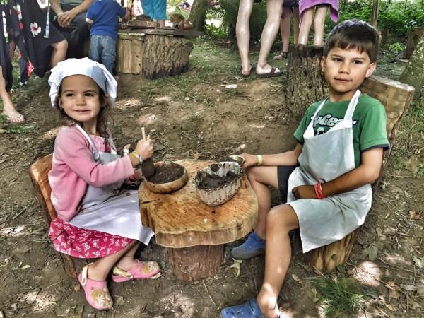 Kara and Toby making mud pies