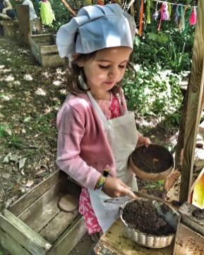 Kara making mudpies
