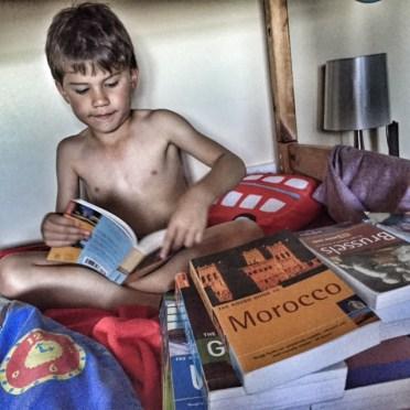 toby-reading-travel-books