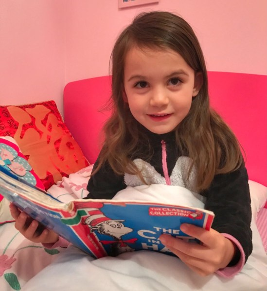 Kara reading The Cat in the Hat, Dr Seuss