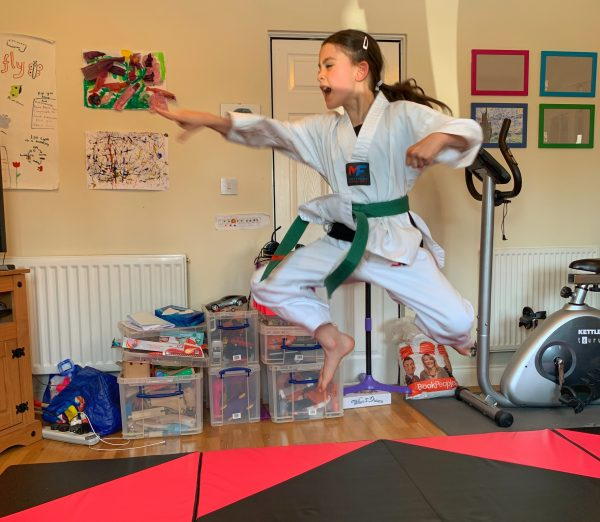 Kara leaping during her martial arts brown belt assessment