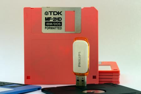 A floppy disk and flash drive