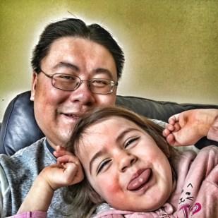 Daddy and Kara pulling face