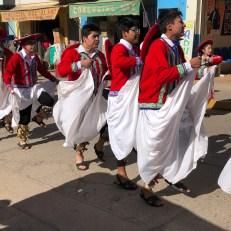 dancers men in costume parade