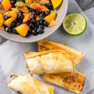 Slow Cooker Crispy Pork Flautas with Blueberry Peach Salsa