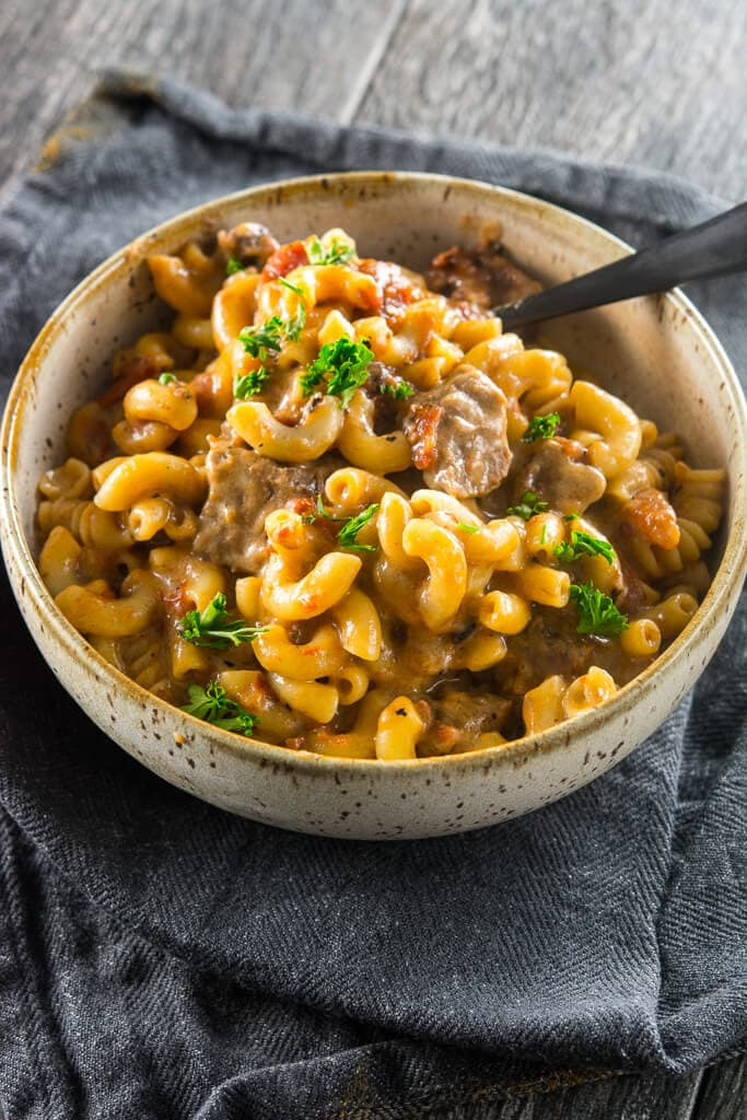 Slow cooker beer mac cheese slow cooker gourmet mac and cheese is amazing on its own but when you add your favorite beer you end up with a grown up comfort food youll want to make again and again forumfinder Images