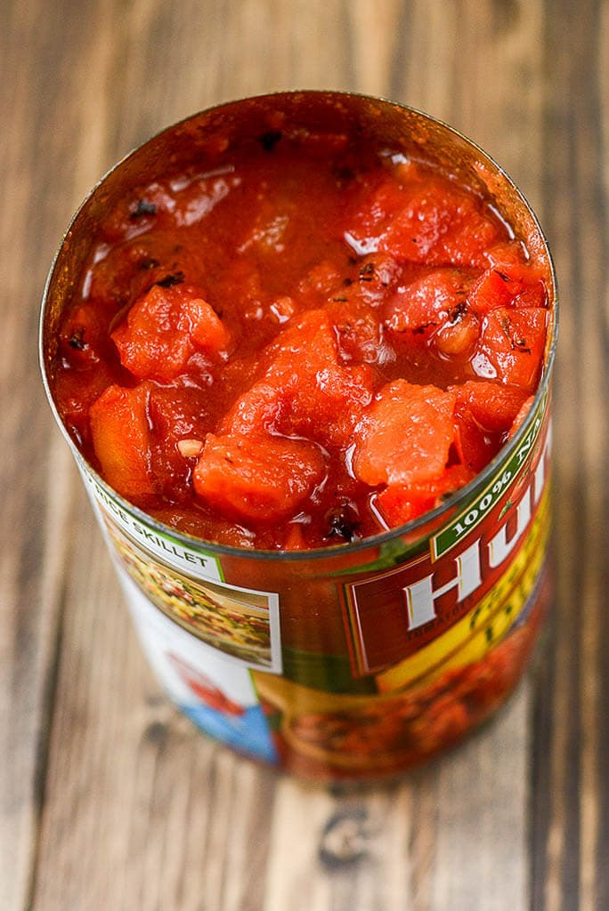 Open can of fire-roasted tomatoes - Slow Cooker Enchilada Soup