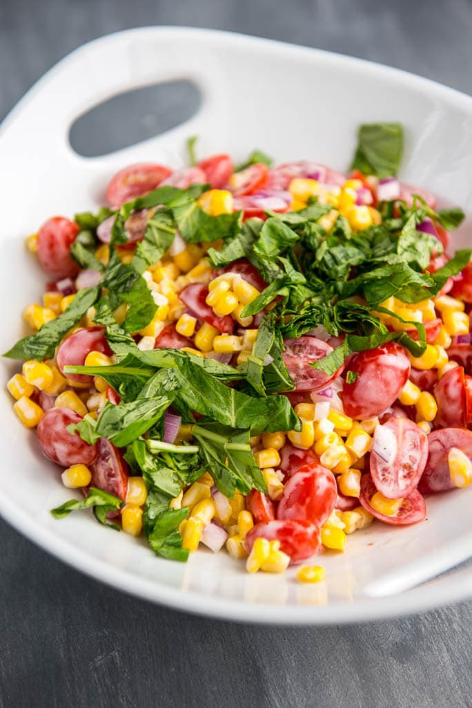 The perfect side dish all summer long! Corn and Tomato Salad is so simple to prepare, so fresh and always a hit!