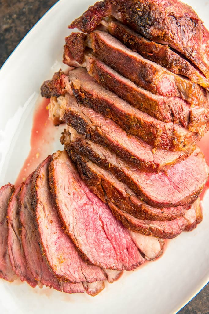 When looking for the best slow cooked beef look no further than this Grilled Tri Tip Roast with Corn Salsa. Amazing on the smoker or pellet grill, you won't get better flavor or more tender meat than this simple delicious meal.